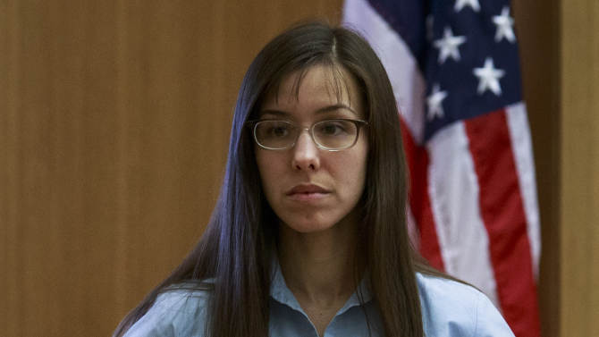 Defendant Jodi Arias takes the stand before she testifies on her behalf during her murder trial in Judge Sherry Stephens' Superior Court in Phoenix, on Tuesday, Feb. 5, 2013. Arias is charged in the stabbing and shooting death of her lover. She first took the stand Monday in a case that has been peppered with lurid stories of sex, lies, betrayal and violence. (AP Photo/The Arizona Republic, Charlie Leight)
