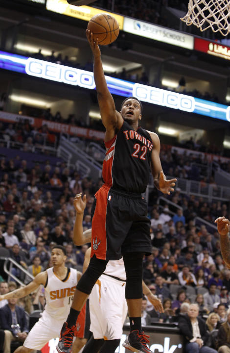 Toronto Raptors' Rudy Gay (22) drives to the basket against the Phoenix Suns during the second half of an NBA basketball game Friday, Dec. 6, 2013 in Phoenix