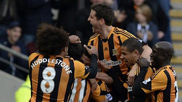 Hull City's players celebrate a goal by Jake Livermore (Reuters)