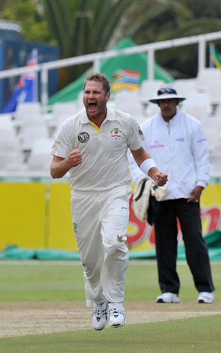 Australian  Ryan Harris celebrates after taking the wicket of unseen South African cricketer  Jacques Rudolph for  18runs  on day 2 of the 1st Test between Australia and  South Africa at Newlands Stad