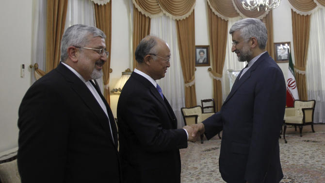Iran's top nuclear negotiator, Saeed Jalili, right, welcomes International Atomic Energy Agency (IAEA) chief Yukiya Amano, center, for their meeting, as Iran's chief delegate to the IAEA Ali Asghar Soltanieh looks on, in Tehran, Iran, Monday, 21, 2012. The head of the U.N. nuclear agency arrived Monday in Tehran on a key mission that could lead to the resumption of probes by the watchdog on whether Iran has secretly worked on an atomic weapon. It would also strength the Islamic Republic's negotiating hand in crucial nuclear talks with six world powers later this week in Baghdad. (AP Photo/IRNA,Adel Pazzyar)