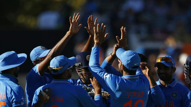 India's Virat Kolhi celebrates with team mates after catching out West Indies batsman Andre Russell for 8 runs during their Cricket World Cup match in Perth