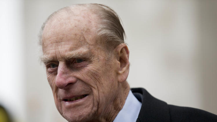 Britain's Prince Philip, the husband of Britain's Queen Elizabeth II, walks to a waiting car as he leaves after the Commonwealth Day Observance at Westminster Abbey in London, Monday, March 11, 2013.  Taking place annually on the second Monday in March, the Commonwealth Day Observance has a different theme every year, with the 2013 focus on 'Opportunity through Enterprise.'  Britain's Queen Elizabeth II, who is the head of the Commonwealth, was due to attend the event, but cancelled as she continues her recovery after a brief illness.  (AP Photo/Matt Dunham-Pool)