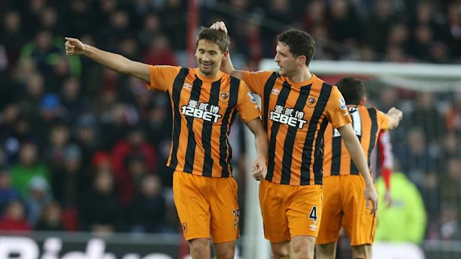 Hull City's Uruguayan midfielder Gaston Ramirez is congratulated by Hull City's Northern Irish defender Alex Bruce (right) after he scores their first goal against Sunderland at The Stadium of Light in Sunderland on December 26, 2014