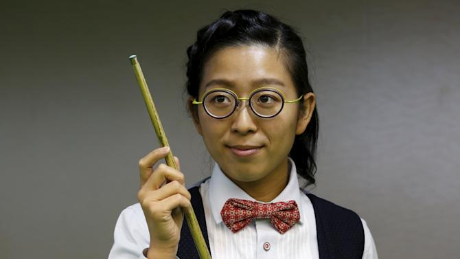 Ng On-yee, 25,  2015 Ladies World Snooker Championship winner, poses during an interview in Hong Kong