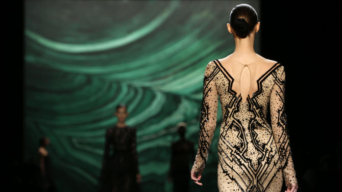 The Monique Lhuillier Fall 2013 collection is modeled during Fashion Week, Saturday, Feb. 9, 2013 in New York.  (AP Photo/Jason DeCrow)