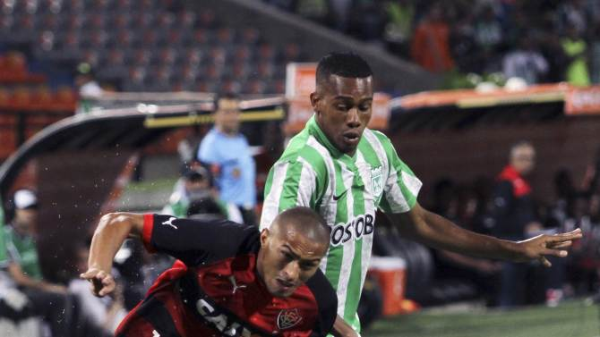 Copete of Atletico Nacional Colombia fights for the ball with Paraiba of Brazil's Vitoria during their Copa Sudamericana match in Medellin