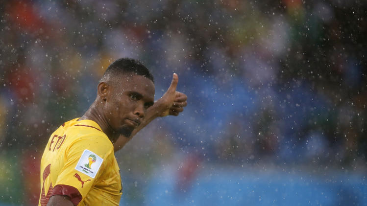 "FILE - In this Friday, June 13, 2014 file photo, Cameroon's Samuel Eto'o gestures during the group A World Cup soccer match between Mexico and Cameroon in the Arena das Dunas in Natal, Brazil. Samuel Eto'o says he is retiring from international football days after being left out of Cameroon's latest squad and stripped of the captaincy. The 33-year-old forward made the announcement Wednesday on his Facebook page, saying ""I wish to thank all Africans in particular and all my fans around the world for their love and unconditional support."" (AP Photo/Sergei Grits, file)"