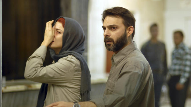 """FILE - In this undated file photo released by Filmiran film distributing company, Iranian actress Leila Hatami, and actor Peyman Moadi, act in a scene of movie """"A Separation"""" which won the Academy Award for best foreign film. Iranian authorities canceled a ceremony Monday in honor of the country's Oscar-winning director even though the government had hailed his win as a triumph over a competitor from Israel. There were no details as to why a permit was denied but some Iranian conservatives were upset with the film's themes: domestic turmoil, gender inequality and the desire by many to leave the country. (AP Photo/Filmiran International Company, Habib Majidi, File)"""