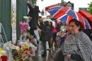 Floral tributes for Drummer Lee Rigby, of the British Army's 2nd Battalion The Royal Regiment of Fusiliers, are lined at the scene of his killing in Woolwich, southeast London