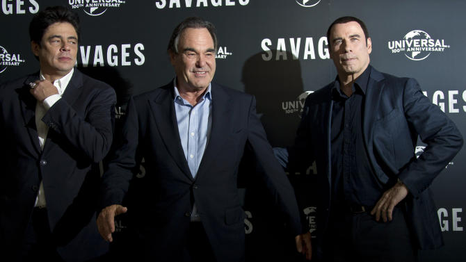 US actor John Travolta, right and Puerto Rican actor Benicio Del Toro with US director Oliver Stone, centre, during the photo call for 'Savages', at a central London hotel, Wednesday, Sept. 19, 2012. (AP Photo/Joel Ryan)