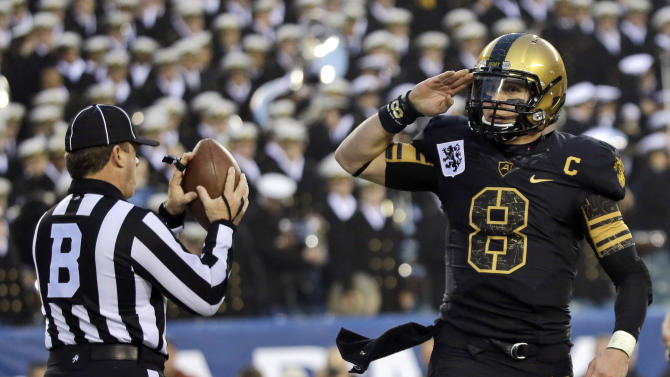 Army's Trent Steelman salutes after scoring a touchdown during the first half of an NCAA college football game against Navy, Saturday, Dec. 8, 2012, in Philadelphia. (AP Photo/Matt Slocum)