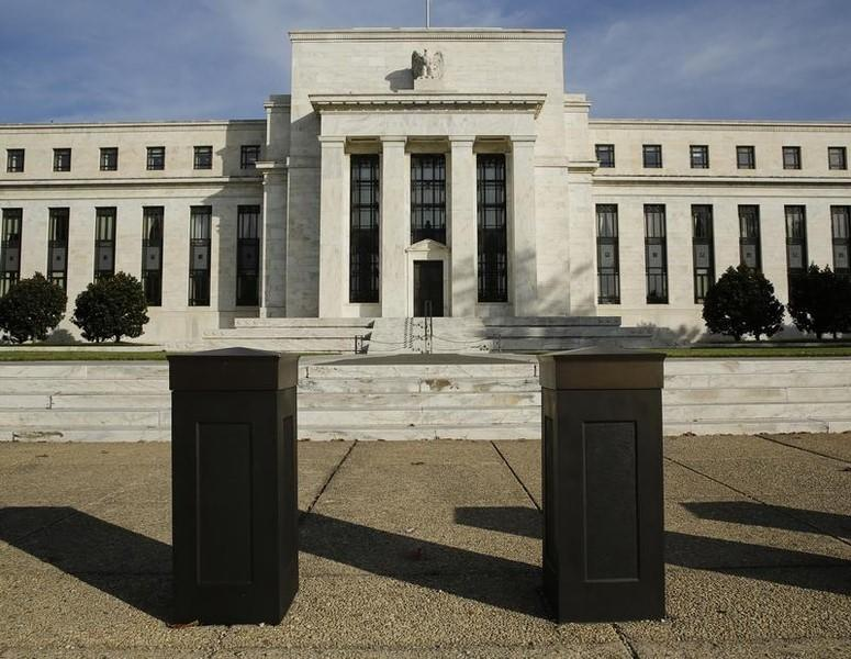U.S. banks pass Fed capital test, trading books hurt
