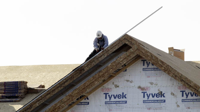 In this Nov. 28, 2012 photo, a worker constructs a home in Chicago. U.S. builders spent less on construction projects in November, the first decline in eight months, as activity was held back by a big drop in spending on federal projects. (AP Photo/Nam Y. Huh)