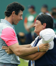 Rory McIlroy celebrates winning the British Open Golf championship with his mother Rosie. (AP)