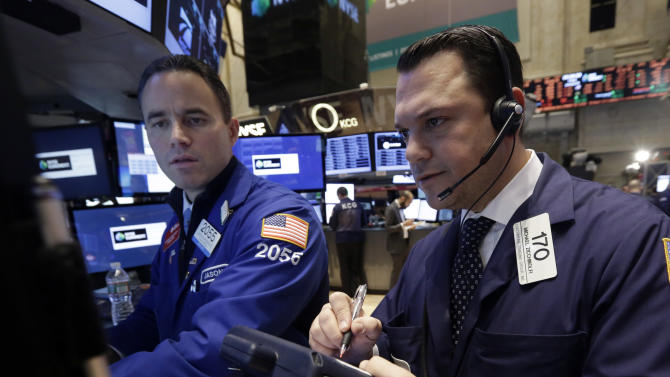 FILE - In this Friday, Jan. 10, 2014, file photo, specialist Jason Hardzewicz, left, and trader Michael Zicchinolfi work on the floor of the New York Stock Exchange. U.S. stock futures were lower shortly before the opening bell, Monday, Jan. 13, 2014, on a week where the pace of company earnings reports picks up. (AP Photo/Richard Drew, File)