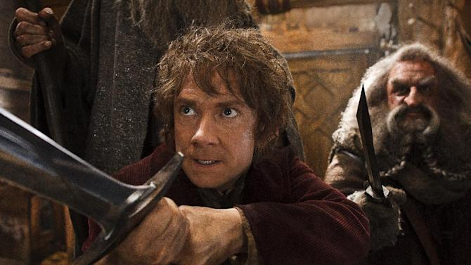 """This image released by Warner Bros. Pictures shows Martin Freeman, left, and John Callen in a scene from """"The Hobbit: The Desolation of Smaug."""" Harvey and Bob Weinstein have sued Warner Bros.' New Line Cinema claiming they're owned a share of the profits from the second and third """"Hobbit"""" films. In a suit filed Wednesday in New York, the Weinsteins say their 1998 sale of the rights to J.R.R. Tolkien's """"The Hobbit"""" and """"The Lord of the Rings"""" trilogy to New Line applies to all subsequent """"Hobbit"""" films. Warner Bros. elected to split """"The Hobbit"""" into three films, the second of which opens in theaters Friday. (AP Photo/Warner Bros. Pictures, Mark Pokorny)"""