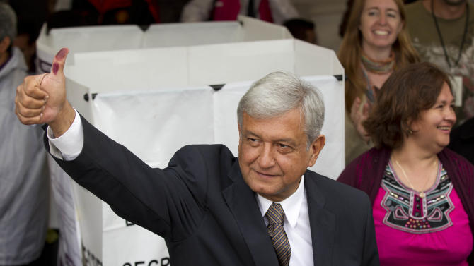 Mexican presidential candidate Andres Manuel Lopez Obrador of the Democratic Revolution Party (PRD)  shows his election ink-stained thumb after casting his vote at a polling station in Mexico City, Sunday, July 1, 2012. Mexico's more than 79 million voters head to the polls Sunday to elect a president, who serves one six-year term, as well as 500 congressional deputies and 128 senators. (AP Photo/Eduardo Verdugo)