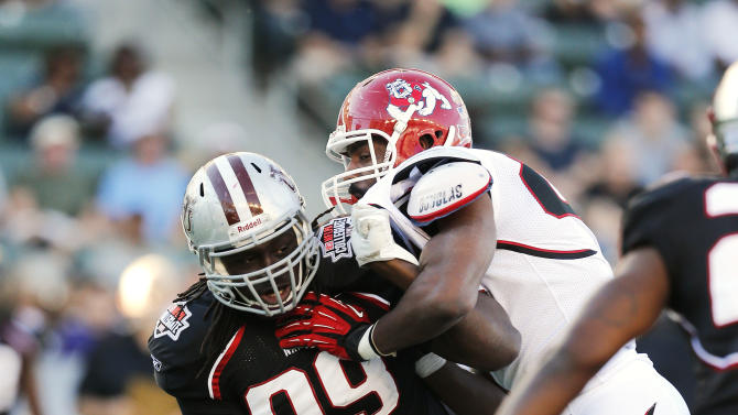 National team defensive end Kentrell Harris (99) of Virginia Union fights through a block during the NFLPA Collegiate Bowl on Saturday, Jan. 19, 2013 in Carson, Calif. (Ric Tapia/AP Images for NFLPA)
