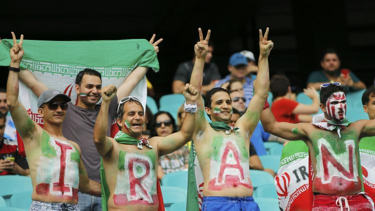 Fans from Iran cheer before their 2014 World Cup Group F soccer match against Bosnia at the Fonte Nova arena in Salvador