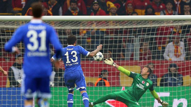 FC Schalke 04's Jermaine Jones, center, scores his goal against Galatasaray during their Champions League round of 16 first leg soccer match at the TT Arena Stadium in Istanbul, Turkey, Wednesday Feb. 20, 2013. (AP Photo)