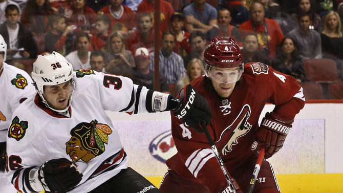 Phoenix Coyotes' Zbynek Michalek (4), of the Czech Republic, gets called for tripping on Chicago Blackhawks' Dave Bolland (36) during the first period in an NHL hockey game Thursday, Feb. 7, 2013, in Glendale, Ariz.(AP Photo/Ross D. Franklin)
