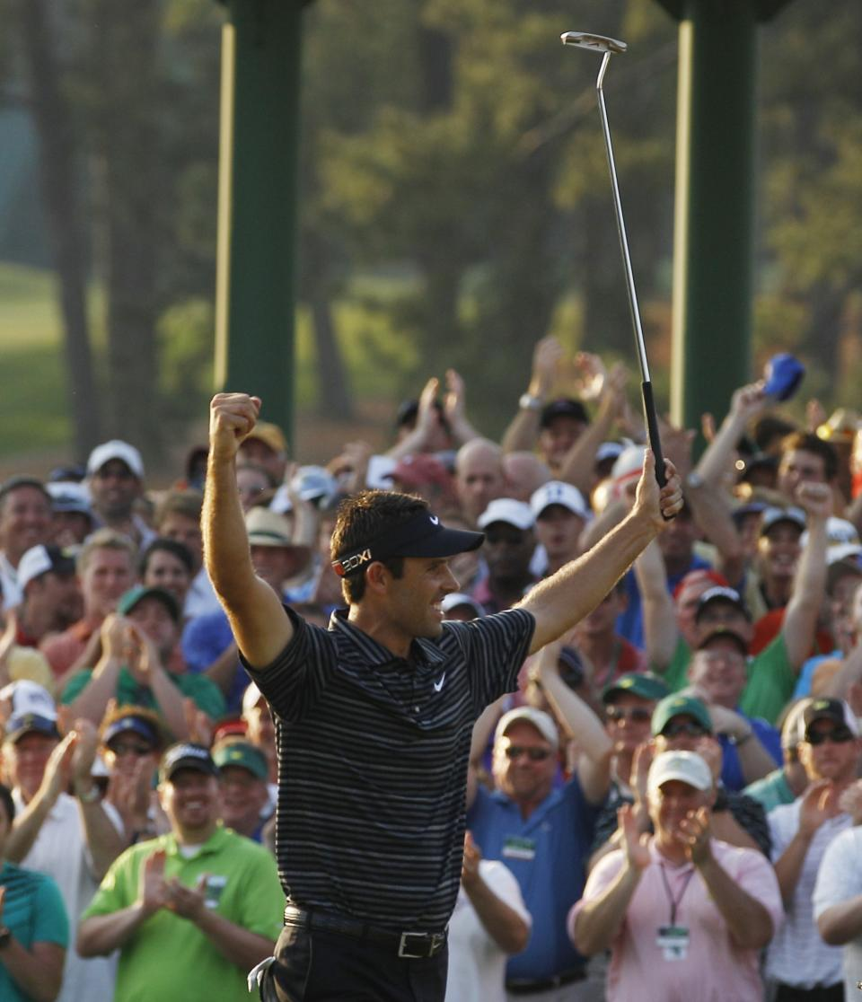 Charl Schwartzel of South Africa reacts after a birdie putt on the 18th hole during the final round of the Masters golf tournament Sunday, April 10, 2011, in Augusta, Ga.  (AP Photo/Matt Slocum)