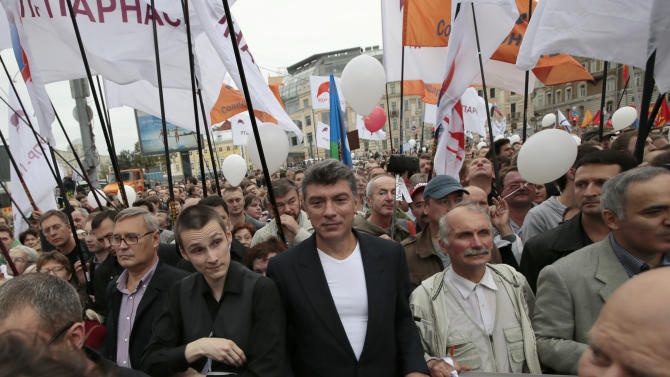 "Opposition leaders Boris Nemtsov, center, and Mikhail Kasyanov, left, take part in a protest demonstration in Moscow, Saturday, Sept. 15, 2012. Tens of thousands marched Saturday across downtown Moscow in the first major protest in three months against President Vladimir Putin, defying the Kremlin's efforts to muzzle dissent. Leftists, liberals and nationalists mixed up with students, teachers, gay activists and others on the capital's tree-lined boulevards, chanting ""Russia without Putin!"" and ""We are the Government!"" (AP Photo/Ivan Sekretarev)"