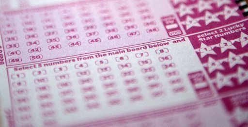 A lottery ticket for the EuroMillions jackpot. A couple who won £101 million in the EuroMillions lottery said Tuesday they would use their winnings to marry and make up to 20 friends and family millionaires