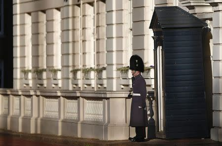 A guardsman stands on duty outside Clarence House in central London