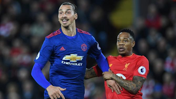 Manchester United's Zlatan Ibrahimovic (L) is marked by Liverpool's Nathaniel Clyne during the English Premier League football match at Anfield in Liverpool, north west England on October 17, 2016
