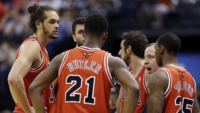 Chicago Bulls head coach Tom Thibodeau, second from right, talks to players including Joakim Noah, left, Jimmy Butler (21) and Marquis Teague (25) in the first half of an NBA basketball game against the Indiana Pacers, Sunday, March 3, 2013, in Indianapolis. (AP Photo/Darron Cummings)