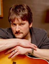 FILE - This March 18, 2011 photo shows country singer Eric Church backstage at the Grand Ole Opry in Nashville, Tenn. Church is the top nominee with seven nominations at the upcoming 48th annual Academy of Country Music Awards. The show will broadcast live on CBS from the MGM Grand Garden Arena in Las Vegas on Sunday, April, 8, 2013. (AP Photo/Ed Rode, File)
