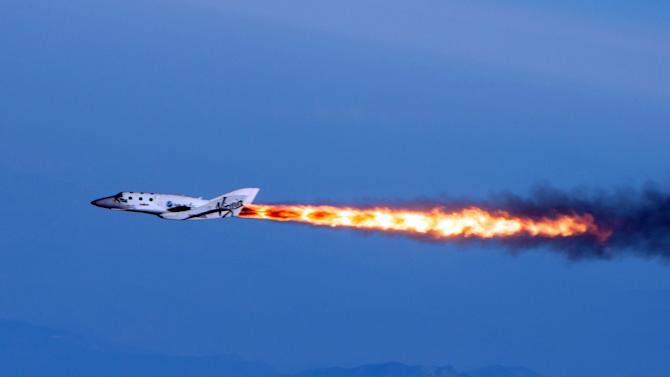 Virgin Galactic's SpaceShipTwo fires its rockets over Mojave, Calif.