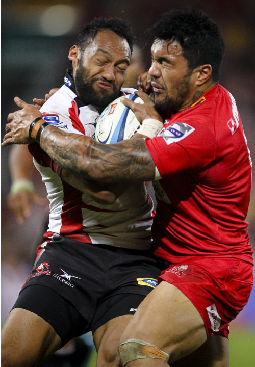 Queensland Reds centre Digby Ioane (R) tackles Golden Lions winger James Kamana during their Super 15 rugby union match at Suncorp Stadium in Brisbane on May 19, 2012.  IMAGE STRICTLY RESTRICTED TO ED