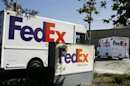 Federal Express trucks head out for deliveries