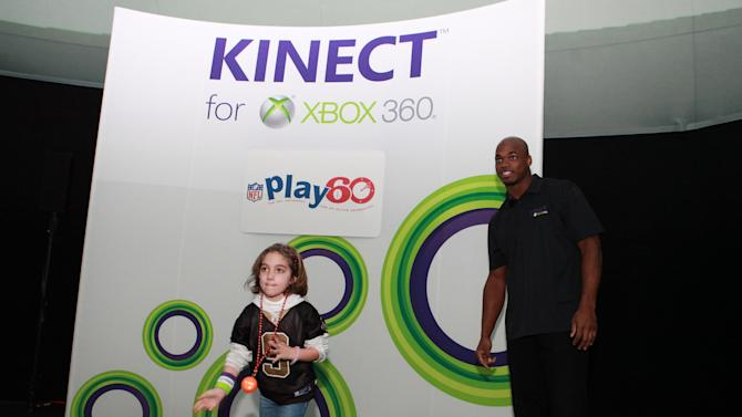 Young Zoe Stein competes against NFL running back Adrian Peterson at Kinect for Xbox 360, on Thursday, Jan. 31, 2013 in New Orleans, LA. (Photo by Barry Brecheisen/Invision for Xbox/AP Images)