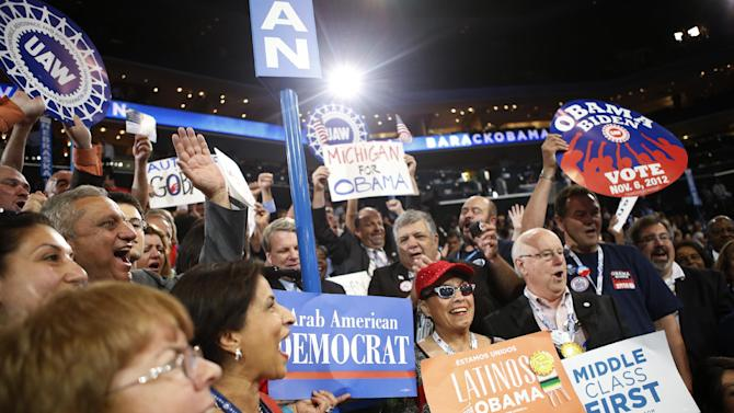 Michigan delegates react as President Barack Obama is nominated for the Office of the President of the United States at the Democratic National Convention in Charlotte, N.C., on Thursday, Sept. 6, 2012. (AP Photo/Jae C. Hong)