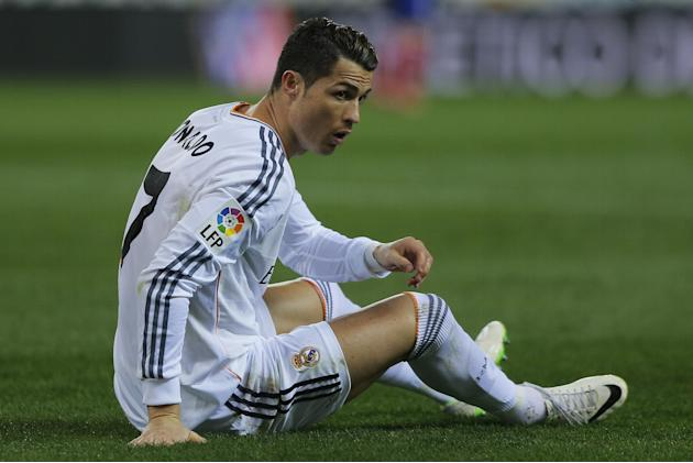 Real's Cristiano Ronaldo on the turf during a semi final, 2nd leg, Copa del Rey soccer match between Atletico de Madrid and Real Madrid at the Vicente Calderon stadium in Madrid, Spain, Tuesday, F