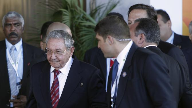 Cuba's President Raul Castro flanked by security officers, arrives for the family photo at the Community of Latin American and Caribbean States (CELAC) summit in San Antonio de Belen