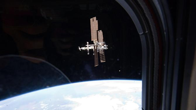 FILE - This Tuesday, July 19, 2011 image provided by NASA shows the International Space Station photographed by a member of Atlantis' STS-135 crew during a fly around as the shuttle departed the station on the last space shuttle mission. A panel of outside experts said Wednesday, Dec. 5, 2012 that NASA is adrift without a coherent vision for where it should be going. The report by the National Academy of Sciences doesn't blame the space agency. It faults the president, Congress and the nation. (AP Photo/NASA)