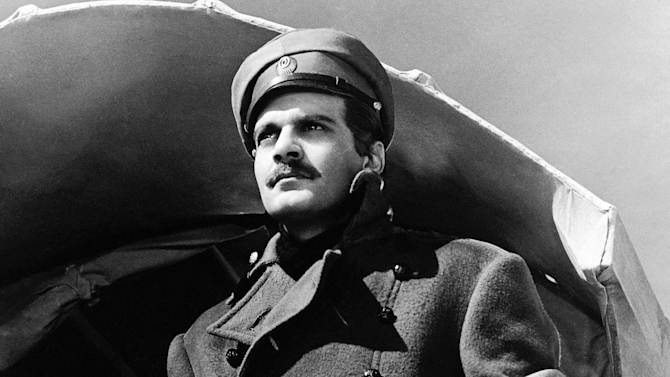 """FILE - In this undated image released by MGM, actor Omar Sharif appears in a scene from the film,""""Doctor Zhivago"""".  Producers said Wednesday, Oct. 1, 2014, that the tale of five intertwined lovers during final days of Czarist Russia will come to the Broadway stage. Previews will March 27 with an opening on April 21. (AP Photo/MGM, File)"""
