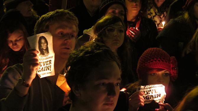 Abortion rights protesters hold candles and pictures in a vigil for Savita Halappanavar outside Ireland's government headquarters in Dublin Saturday, Nov. 17, 2012. Thousands marched to the spot to demand that the government draft a law defining when abortions can be performed to save a woman's life. Ireland has been shocked by the death of Halappanavar, a 31-year-old Indian dentist who died of blood poisoning after being denied an abortion in a Dublin hospital last month. (AP Photo/Shawn Pogatchnik)