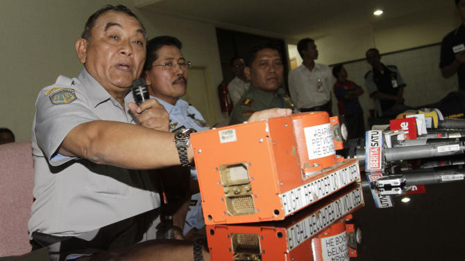 Indonesian National Transportation Safety Board chief Tatang Kurniadi with the flight data recorder of the crashed Sukhoi Superjet 100 speaks during a press conference in Jakarta, Indonesia, Thursday, May 31, 2012. Authorities found the flight data recorder of the Russian plane that slammed into a jungle-clad cliff atop an Indonesian volcano during a May 9 demonstration flight for potential buyers. (AP Photo/Achmad Ibrahim)