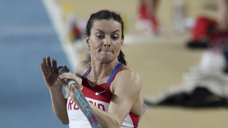 Russia's Yelena Isinbayeva makes an attempt in the Women's Pole Vault final during the World Indoor Athletics Championships in Istanbul, Turkey, Sunday, March 11, 2012. (AP Photo/Michael Probst)