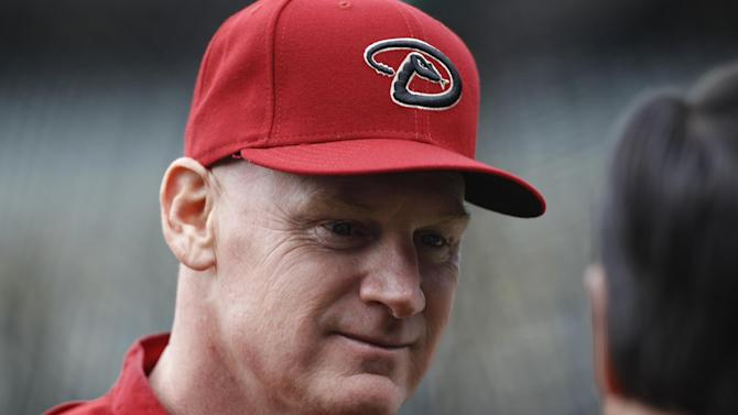 FILE - In this April 20, 2013 file photo, Arizona Diamondbacks third base coach Matt Williams chats with William Geivett, assistant general manager of the Colorado Rockies, before the first inning of a Major League Baseball game in Denver. Williams is the new manager of the Washington Nationals. The Nationals will hold a news conference Friday to introduce Williams as the team's fifth manager since it moved to Washington from Montreal in 2005. He replaces Davey Johnson, who is retiring. (AP Photo/David Zalubowski, File)