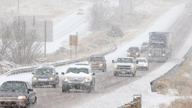 Inbound traffic on I-25 approaches Santa Fe, N.M. in a single file as snow accumulates on the road, Monday Dec. 19, 2011 as a winter storm hit the area. New Mexico state police say a winter storm is shutting highways and causing difficult driving across northern New Mexico. Los Alamos National Laboratory and a number of schools have closed as the storm moves across New Mexico and into the Texas and Oklahoma Panhandles and parts of Kansas and Colorado.   (AP Photo/The New Mexican, Clyde Mueller)