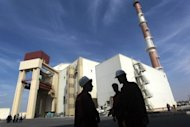 "The reactor building at the Russian-built Bushehr nuclear power plant, 1200 kms south of Tehran, in October 2010. Iran ""will never stop"" its controversial uranium enrichment, the country's envoy to the IAEA said on Tuesday, on the sidelines of a Non-Aligned Movement ministerial meeting in Tehran. (AFP Photo/Majid Asgaripour)"