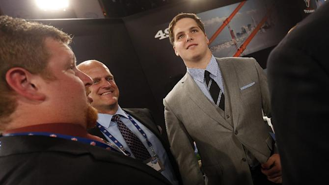 Luke Joeckel, right, from Texas A&M, stands in the green room before the first round of the NFL football draft, Thursday, April 25, 2013 at Radio City Music Hall in New York.  (AP Photo/Jason DeCrow)