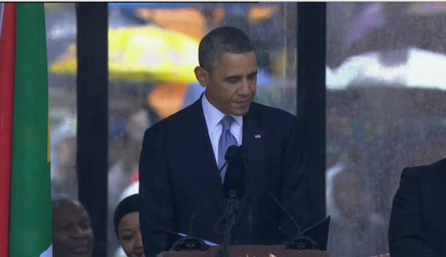 In this image from TV, US President Barack Obama speaks to the assembled crowds at the FNB Stadium in Soweto, South Africa, in the rain for a memorial service for former South African President Nelson